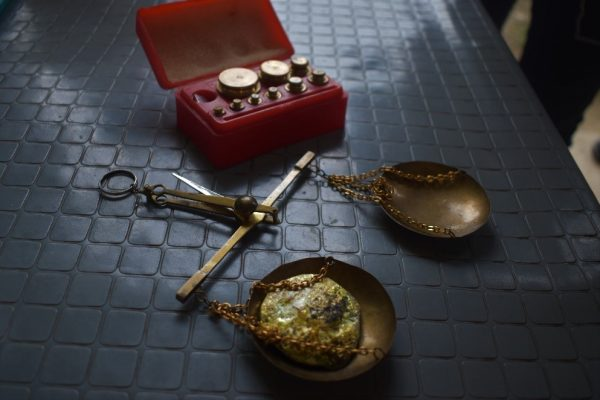 A balance scale with locally produced artisanal gold in Itogon, Benguet, Philippines