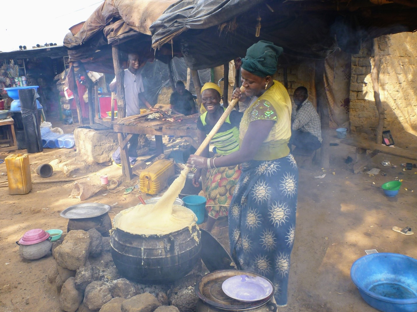 Women performing household chores (Photo credit Dr. Kevin Telmer, Artisanal Gold Council)