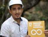 Miner with SDG 12 sign
