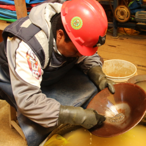 Small-scale miner in Puno, Peru panning to extract gold