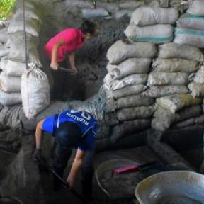 Women sack ore at a processing plant - AGC Philippines image